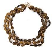 1089 A 14 Karat Yellow Gold and Tigerseye Quartz Tripl