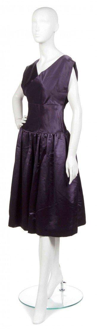 21: A Norman Norell Plum Satin Cocktail Dress,