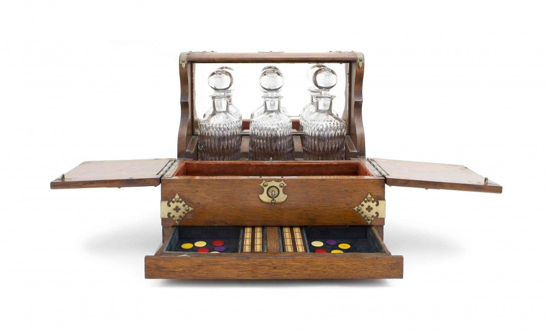 12: An English Oak Liquor Set, Height 13 inches.