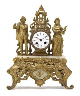 A Continental Gilt Metal And Marble Mantel Clock,