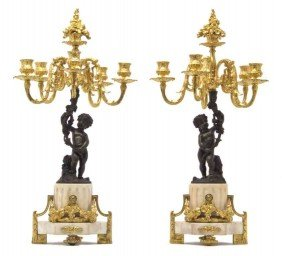 A Pair Of Louis XVI Style Patinated And Gilt Bronz