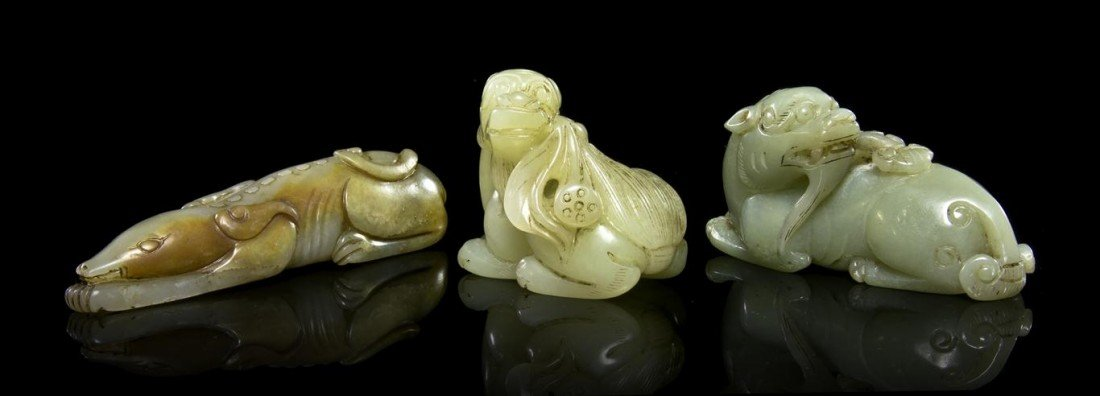 431: A Group of Three Jade Animal-Form Toggles, Length