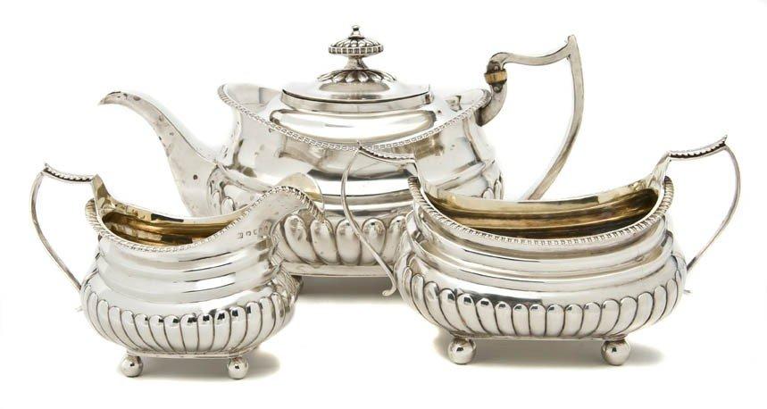 461: An English Silver Assembled Three-Piece Tea Set, W