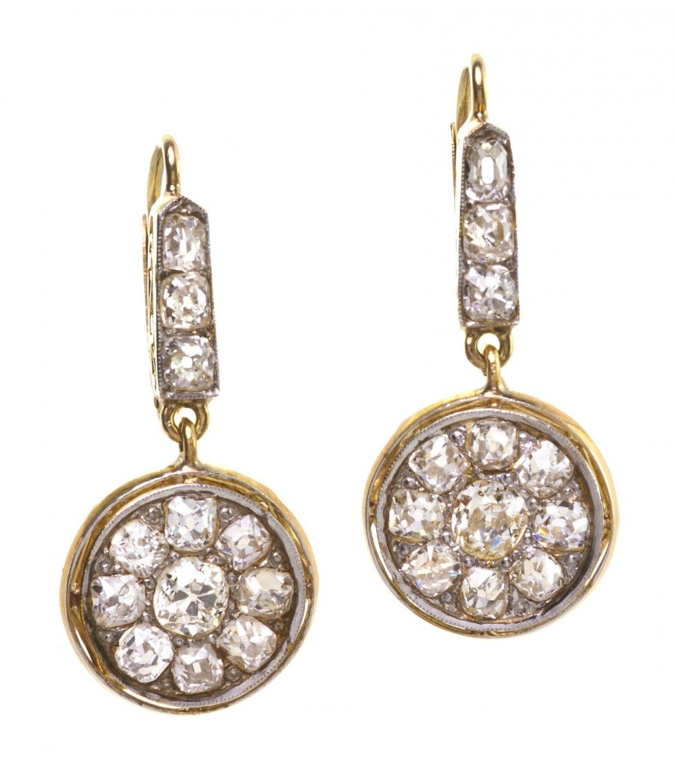 12: A Pair of 18 Karat Yellow Gold and Diamond Earrings