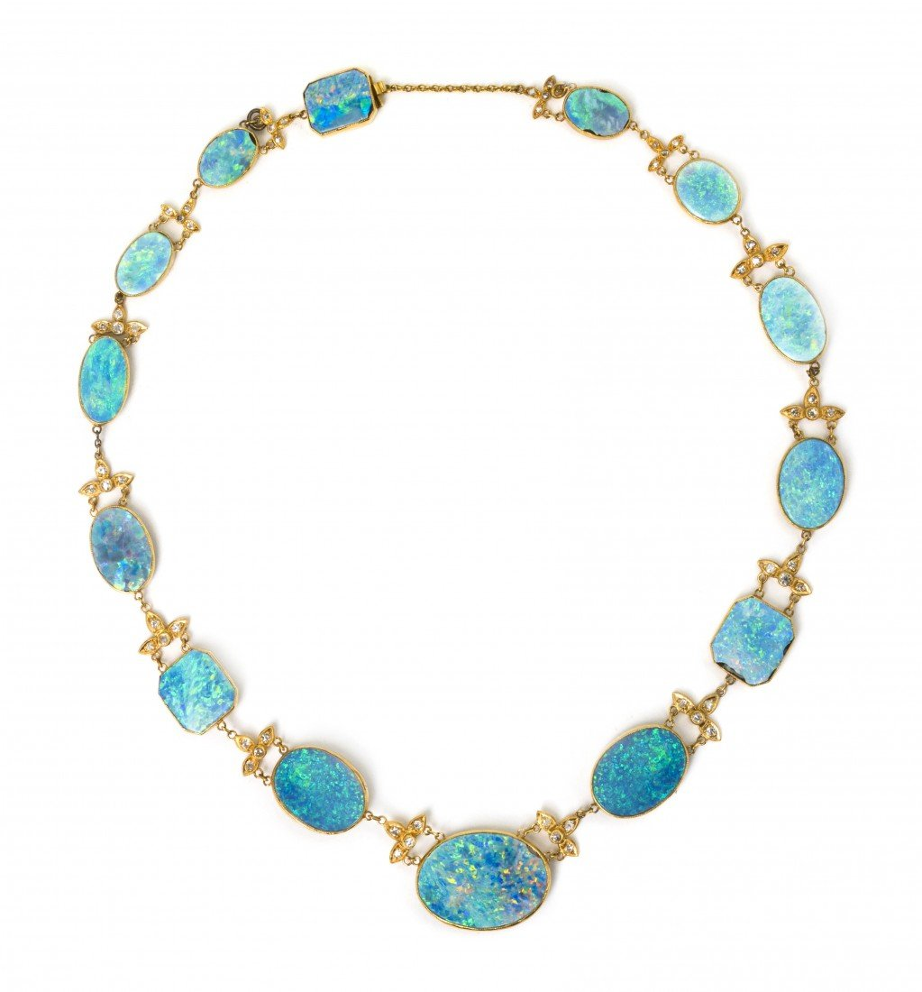 19: A Graduated Opal Doublet and Diamond Necklace, 17.5
