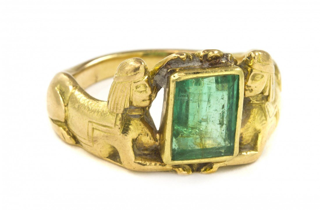 23: An 18 Karat Yellow Gold and Emerald Egyptian Motif