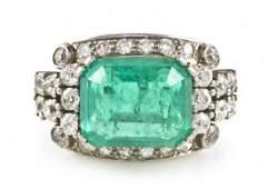 139 An Art Deco Platinum Emerald and Diamond Ring 7