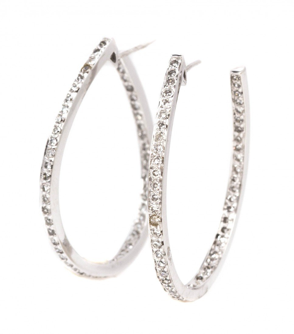 461: A Pair of 14 Karat White Gold and Diamond Inside O