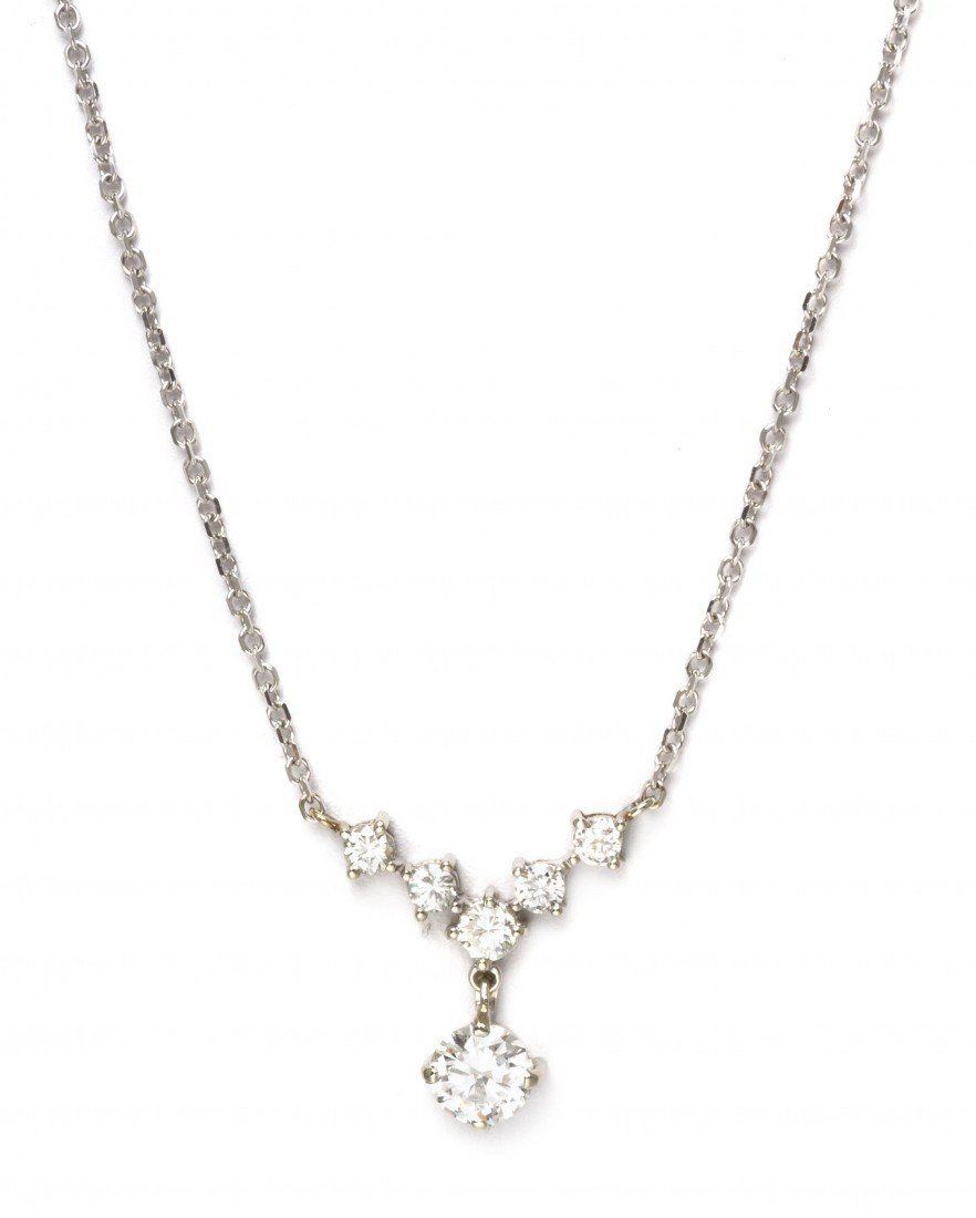 467: A 14 Karat White Gold and Diamond Pendant Necklace