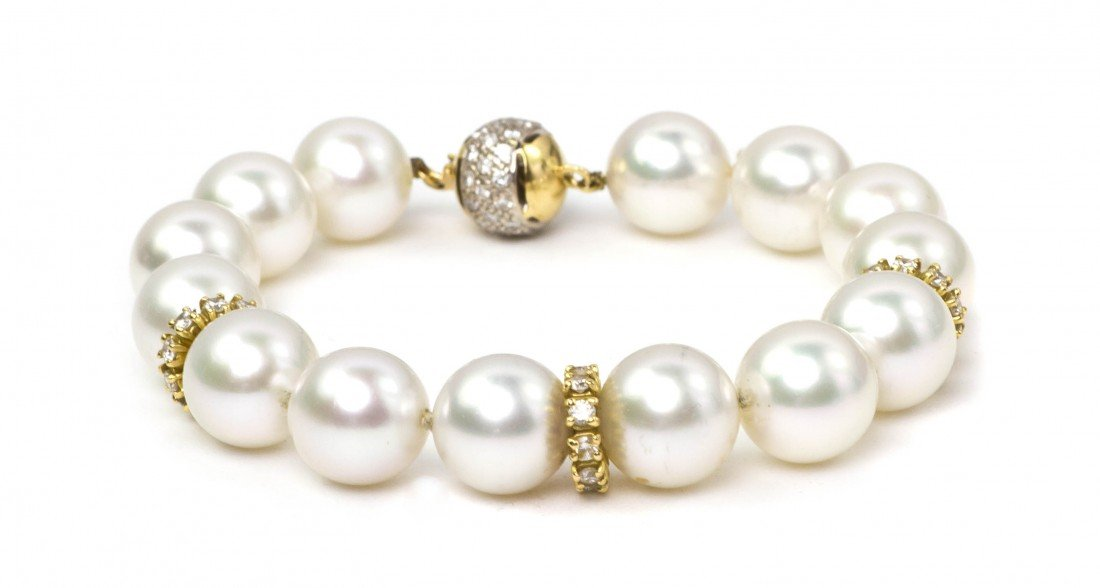 478: An 18 Karat Gold, Cultured Pearl and Diamond Brace