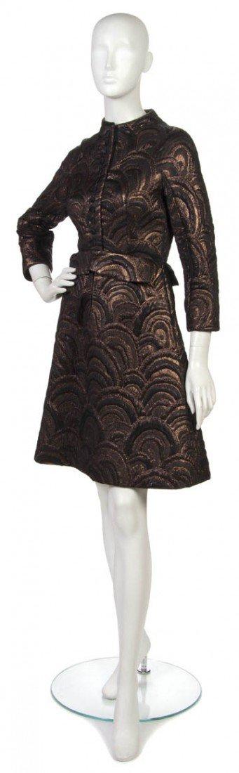 7: An Arnold Scaasi Brown Lurex Dress.