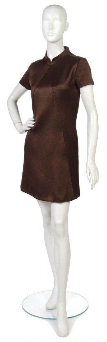 14: An Arnold Scaasi Brown Mini Dress.