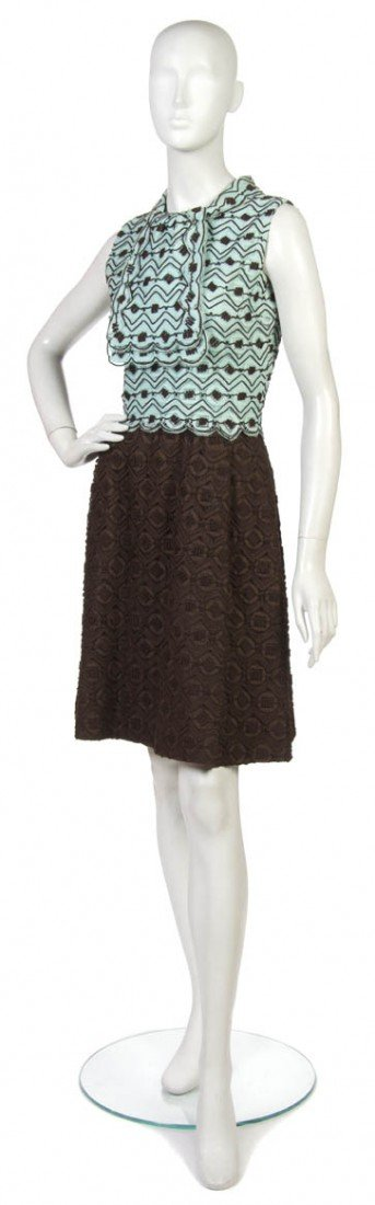 15: An Arnold Scaasi Brown and Blue Lace Dress Suit.