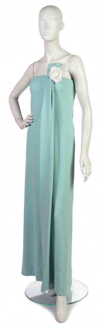 18: An Arnold Scaasi Light Blue Silk Evening Gown,