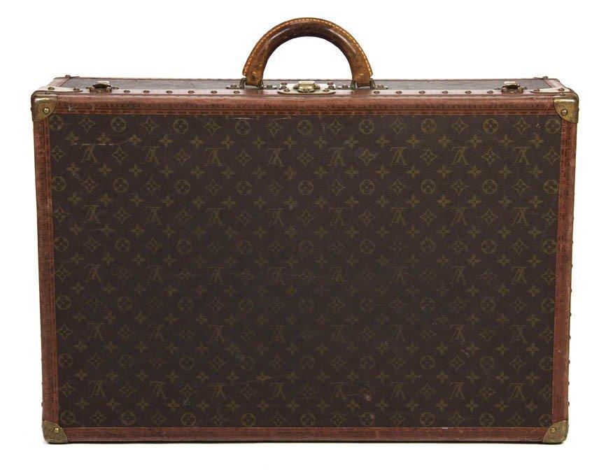 426: A Louis Vuitton Monogram Canvas Hardsided Suitcase