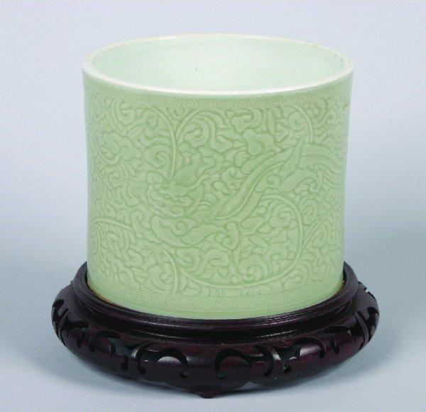 9:A Chinese Carved Celadon Glazed Porcelain Brushpot,