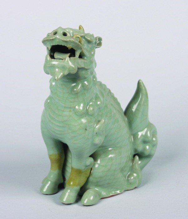 11: A Chinese Celadon Glazed Ceramic Buddhist Lion, Hei