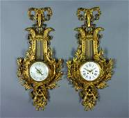 105: A Louis XVI Gilt-Bronze Cartel Clock Case and a Lo