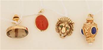 1437 A Collection of Interesting Yellow Gold Jewel Obj