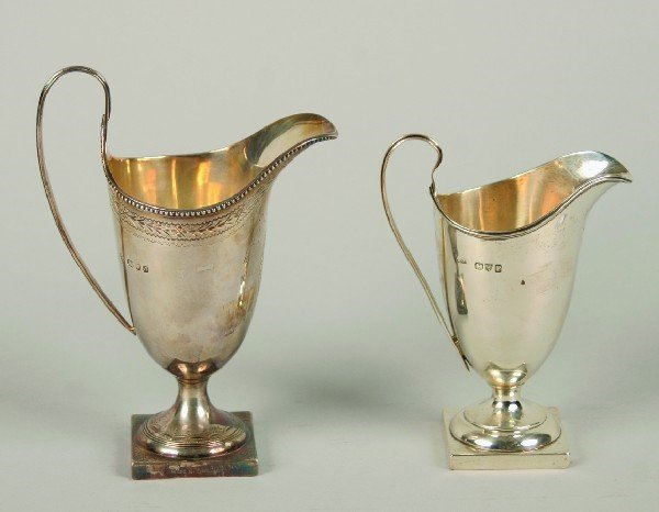 1542: A Group of Two English Silver Helmet Form Creamer