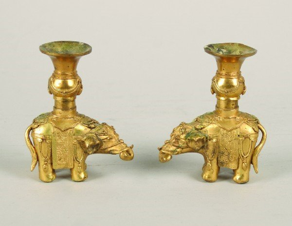 1984: A Pair of Chinese Gilt Bronze Elephant Form Candl