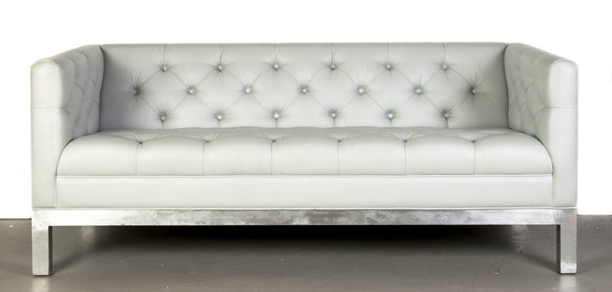 24: A Leather Upholstered Settee, Width 66 inches.