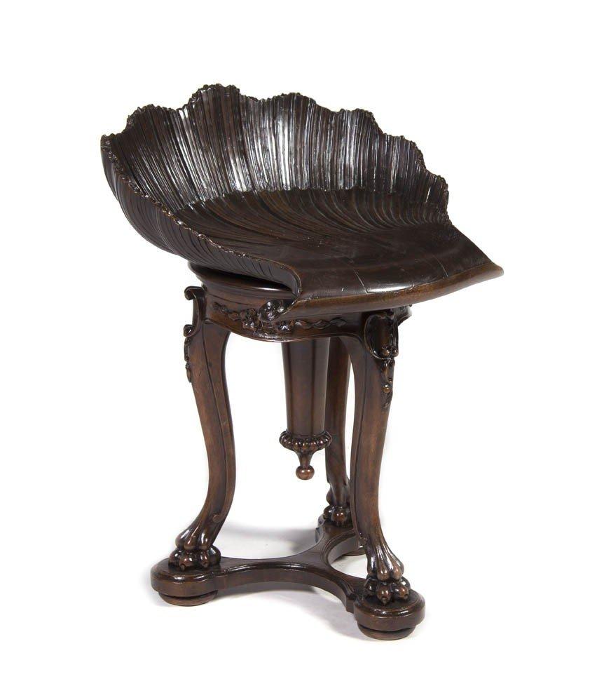 73: A Victorian Carved Mahogany Organ Stool, Height 25