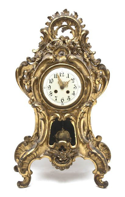 4: A Louis XV Style Giltwood Mantel Clock, Height 23 in