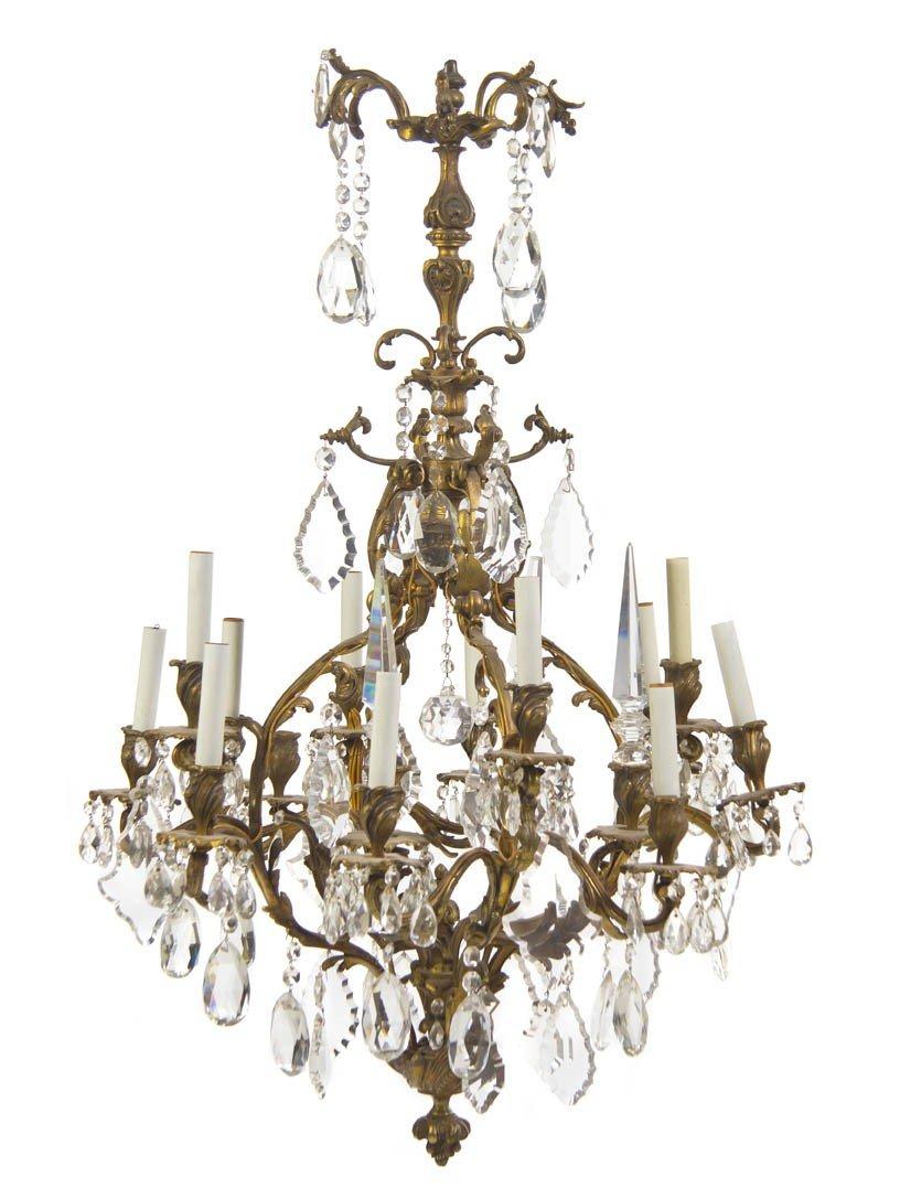 14: A Louis XV Style Bronze Sixteen-Light Chandelier, H