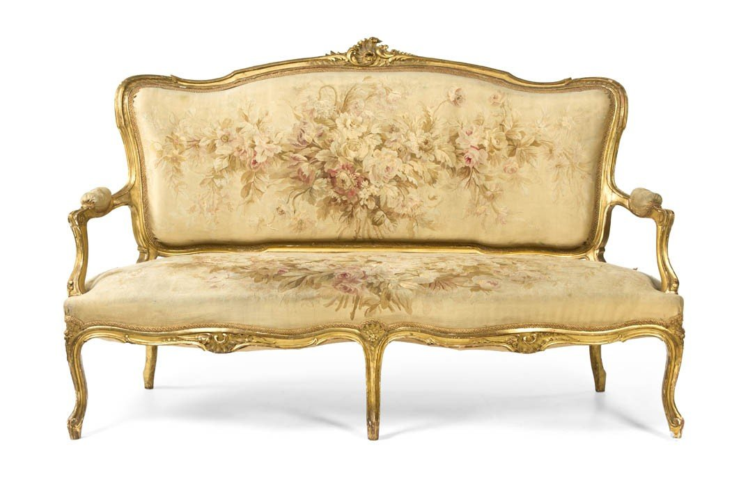 19: A Louis XV Giltwood Canape, Height 41 x width 64 x