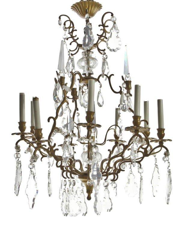24: A Continental Bronze Nine-Light Chandelier, Height