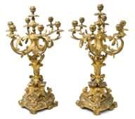 55 A Pair of Louis XV Gilt Bronze SevenLight Candelab