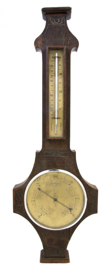 533: An Oak Wheel Barometer, Height 28 3/4 inches.