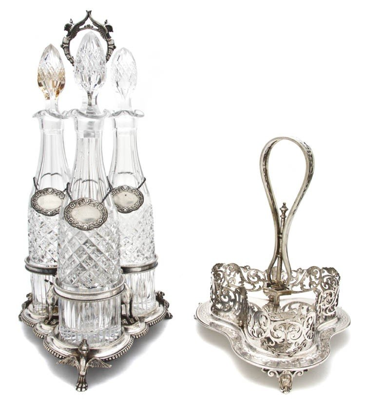 685: A Silverplate and Cut Glass Decanter Set, Height o
