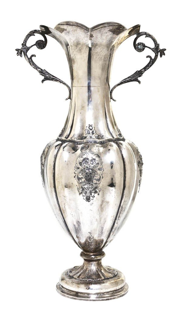 1011: An Italian Silver Vase, Height 17 inches.