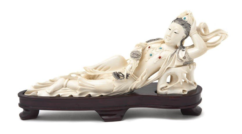 2572: A Carved Chinese Ivory Figure, Width 11 inches.