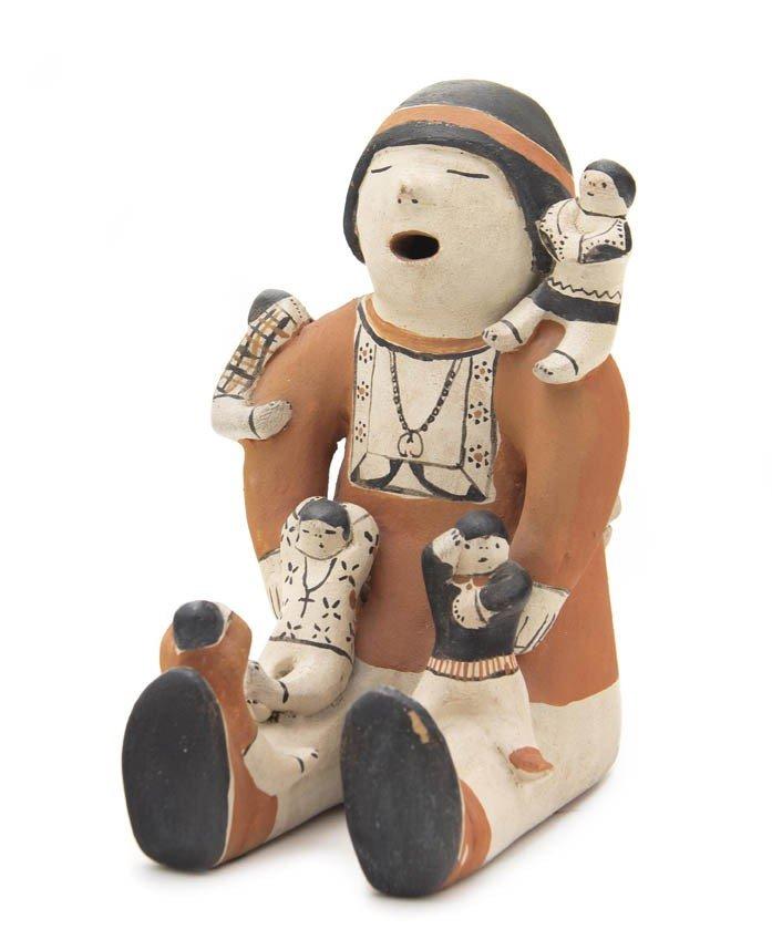 98: A Cochiti Storyteller, Height 9 x diameter 10 inche