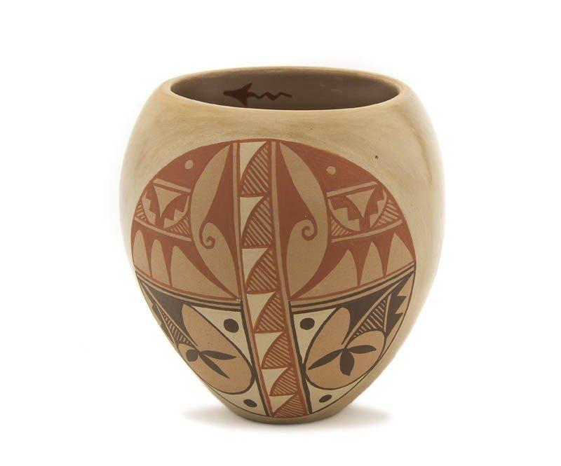 108: A Jemez Jar, Height 6 x diameter 5 3/4 inches.