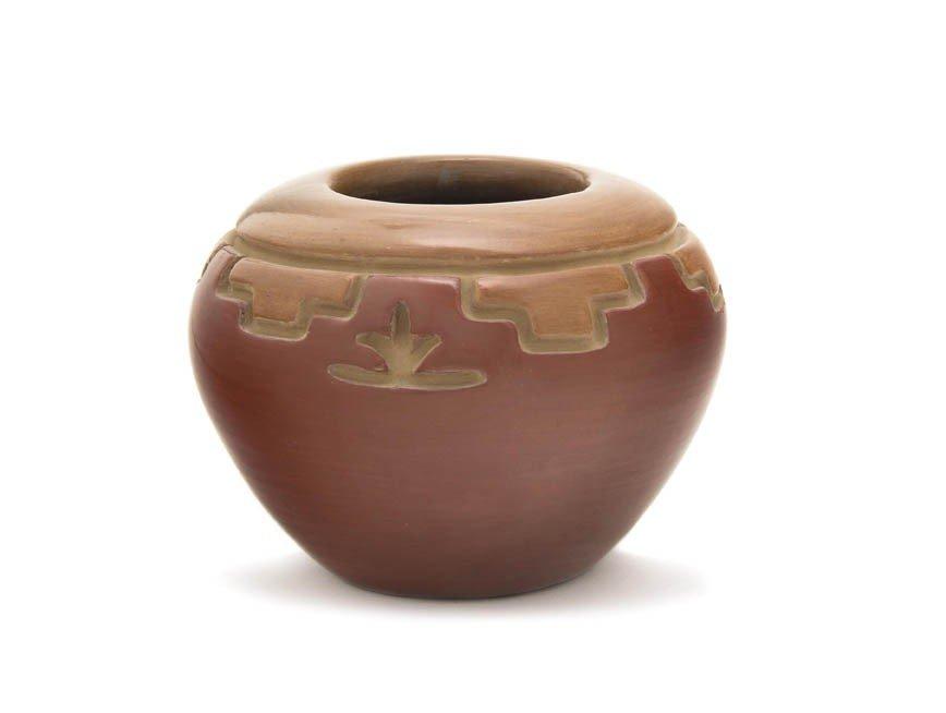 111: A San Juan Two Colored Redware Jar, Height 4 x dia