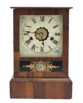 An American Eglomise Clock, Height 12 Inches.
