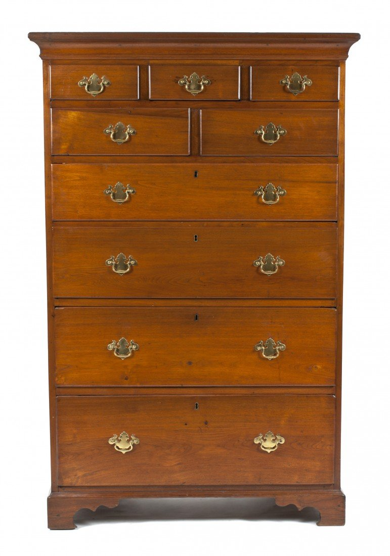 24: An American Chippendale Style Walnut Chest of Drawe