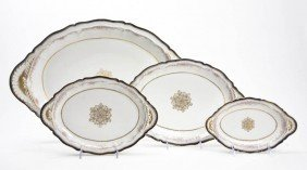 A Set Of Four Limoges Porcelain Graduated Trays,