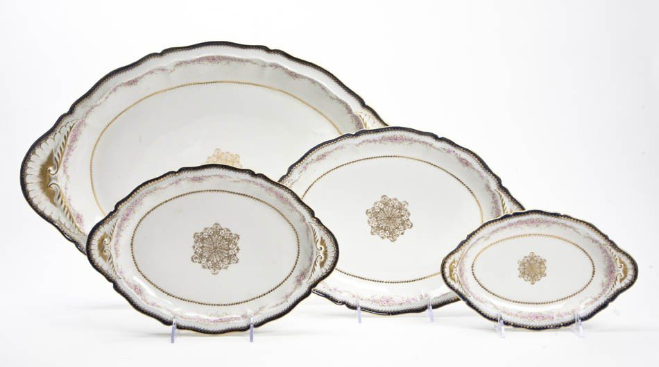 2083: A Set of Four Limoges Porcelain Graduated Trays,
