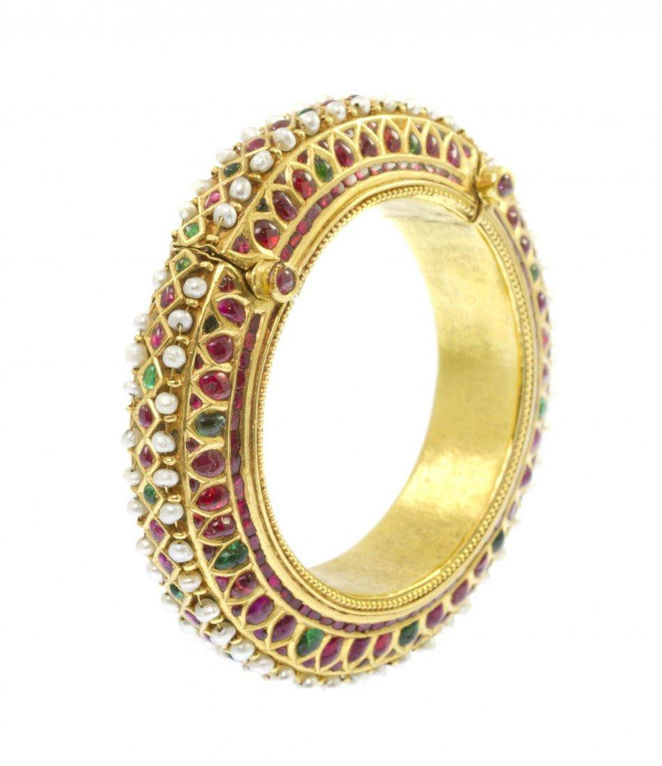 11: A Gold, Ruby, Emerald and Pearl Mughal Bangle Brace