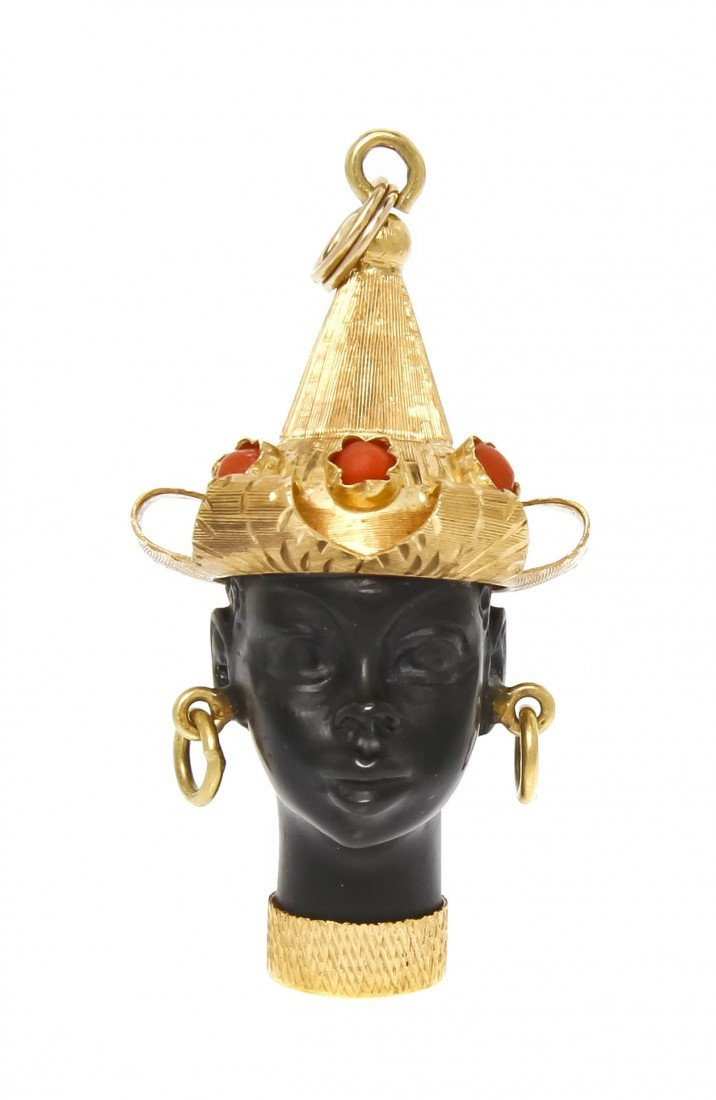 17: A 14 Karat Yellow Gold, Glass and Coral Blackamoor