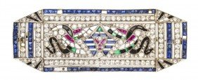 An Art Deco Egyptian Revival Platinum, Diamond And