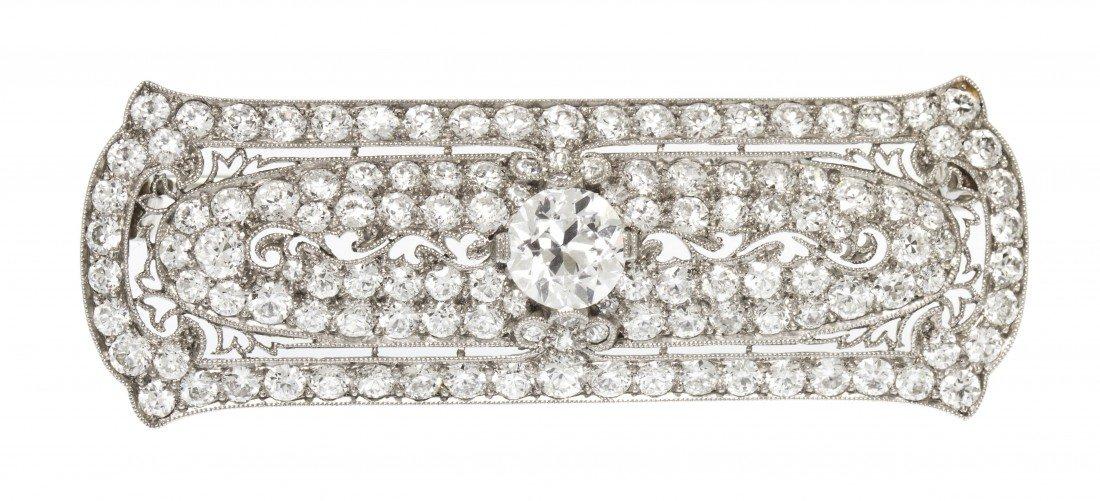 51: An Art Deco Platinum and Diamond Bar Brooch, 6.00 d