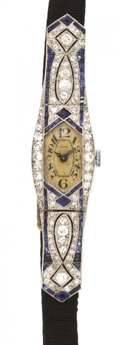 53: An Art Deco Platinum, Diamond and Sapphire Wristwat