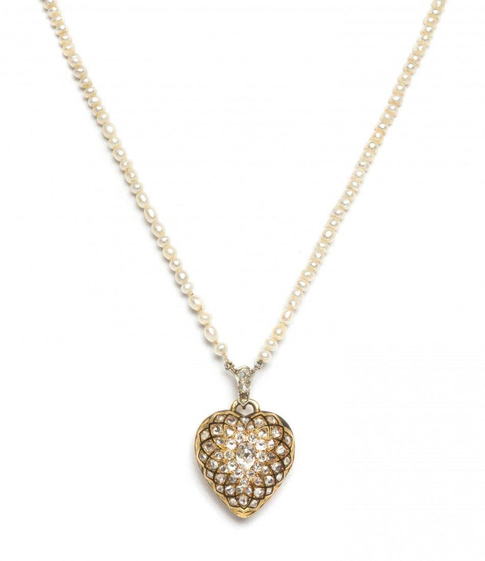 57: A Victorian Gold, Diamond and Enamel Heart Shape Lo