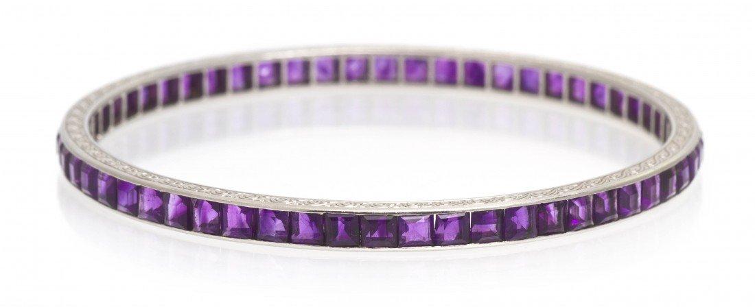 58: An Edwardian Platinum and Amethyst Bangle Bracelet,